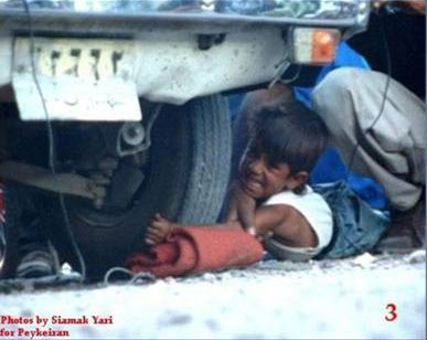Iran boy arm under car wheel 3