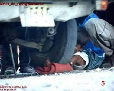Iran boy arm under car wheel 5