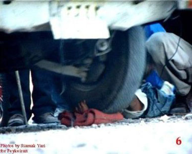 Iran boy arm under car wheel 6